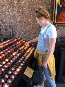 lighting-candles-holy-cross-chapel-sedona-arizona