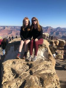 sisters-grand-canyon-south-rim-sitting-on-rock
